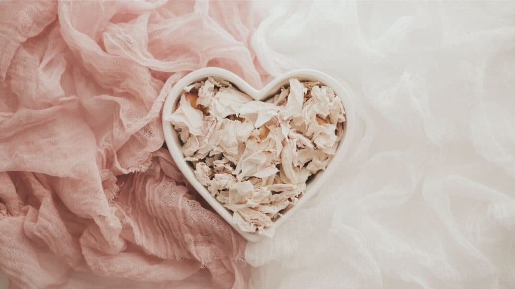 heart-shaped bowl of potpourri scarves around it
