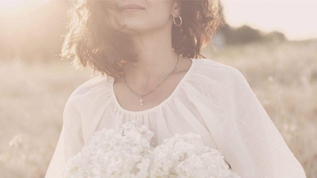 woman flowers standing in field