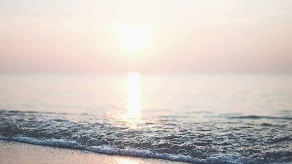 beach at sunset thinking Am I sure I'll go to heaven?