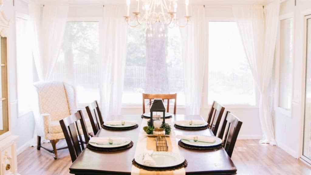 dining room table place setting large windows