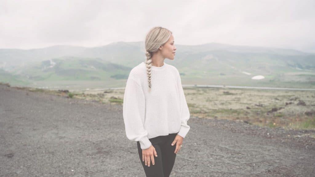 woman braid mountains background